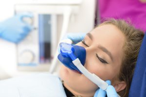 woman inhalation sedation at dental clinic